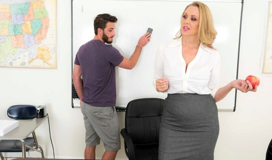 Mature lady in the office is enjoying sex with young student