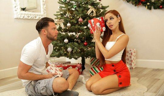 Redhead girlfriend before Christmas gives the boy a real fuck under the tree