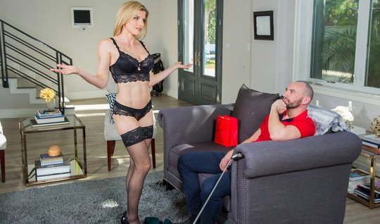 Blonde in stockings and shoes fucks on a gray couch with an unshaven dude...