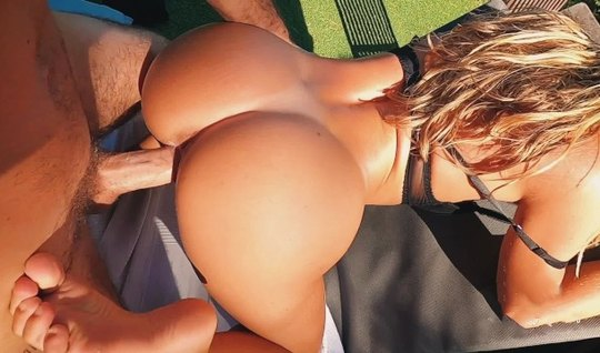 Blonde outdoors bent over into a doggystyle position for fucking with a big cock