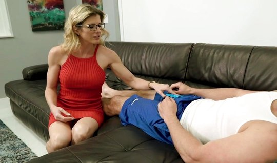 The hunk gets a long and cool blowjob on the couch from a mature mom in a red dress...