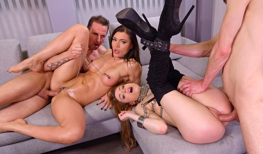 Tattooed girlfriends on the couch get double penetrated by a group of guys