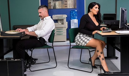 Busty brunette at the office gives a fuck right on your desktop