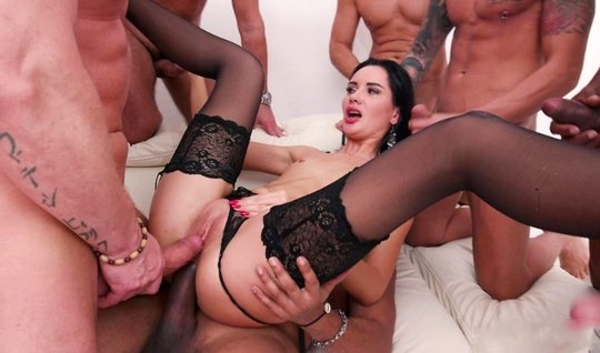 Brunette in stockings experiencing the thrill of double penetration...